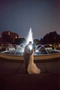 Bride and Groom by water fountain
